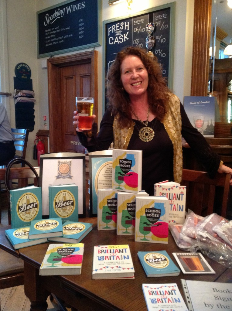Jane Peyton with her beer and her books
